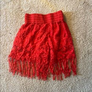 Red knitted lace  skirt with built in shorts.